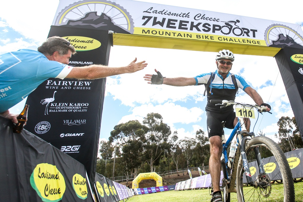 An 82km marathon finisher gets a high five from an earlier finisher of the Ladismith Cheese 7Weekspoort MTB Challenge, on the 1st October 2016  Photo by:    /Oakpics/ SPORTZPICS   {dem16gst}